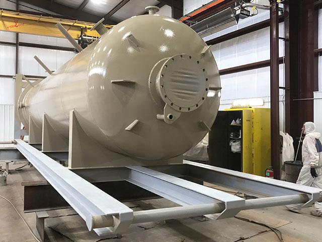 Applying coatings to an ASME vessel
