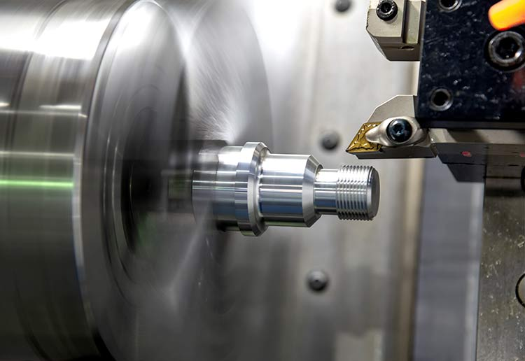 Component turning in a CNC machine